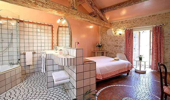 photo of a bedroom and bathroom