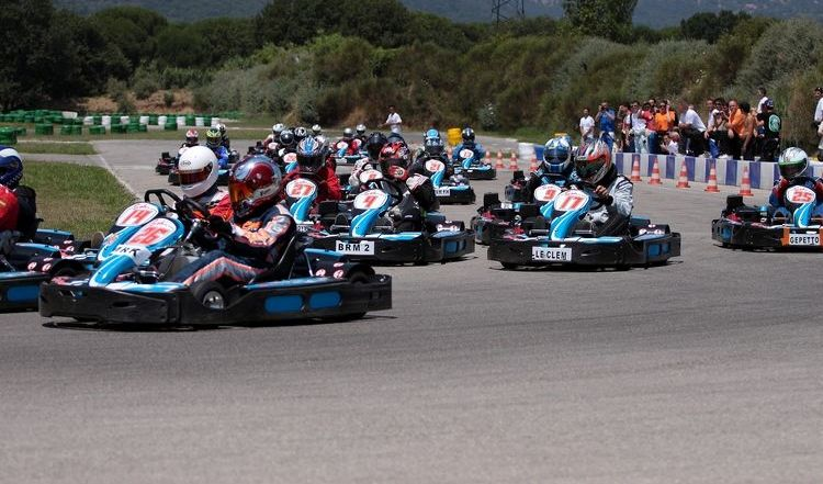 many karts in a race on outdoor track