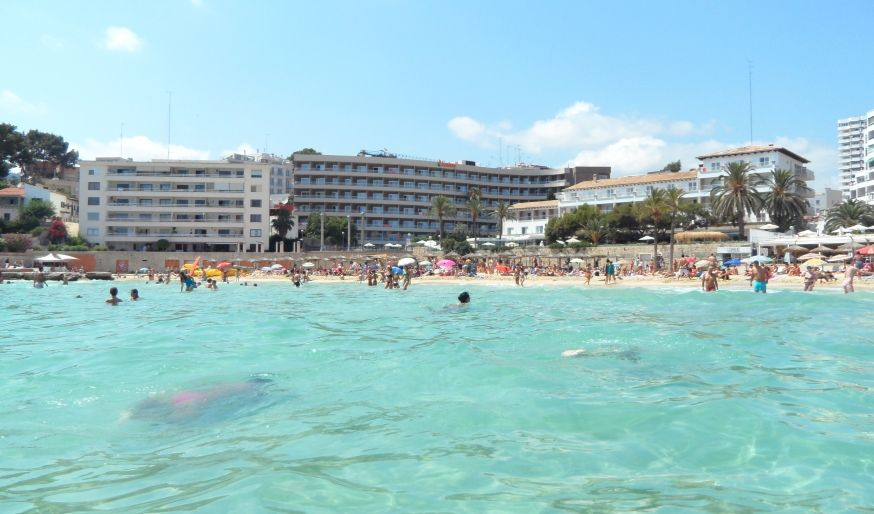 photo of swimmers and water at cala mayor