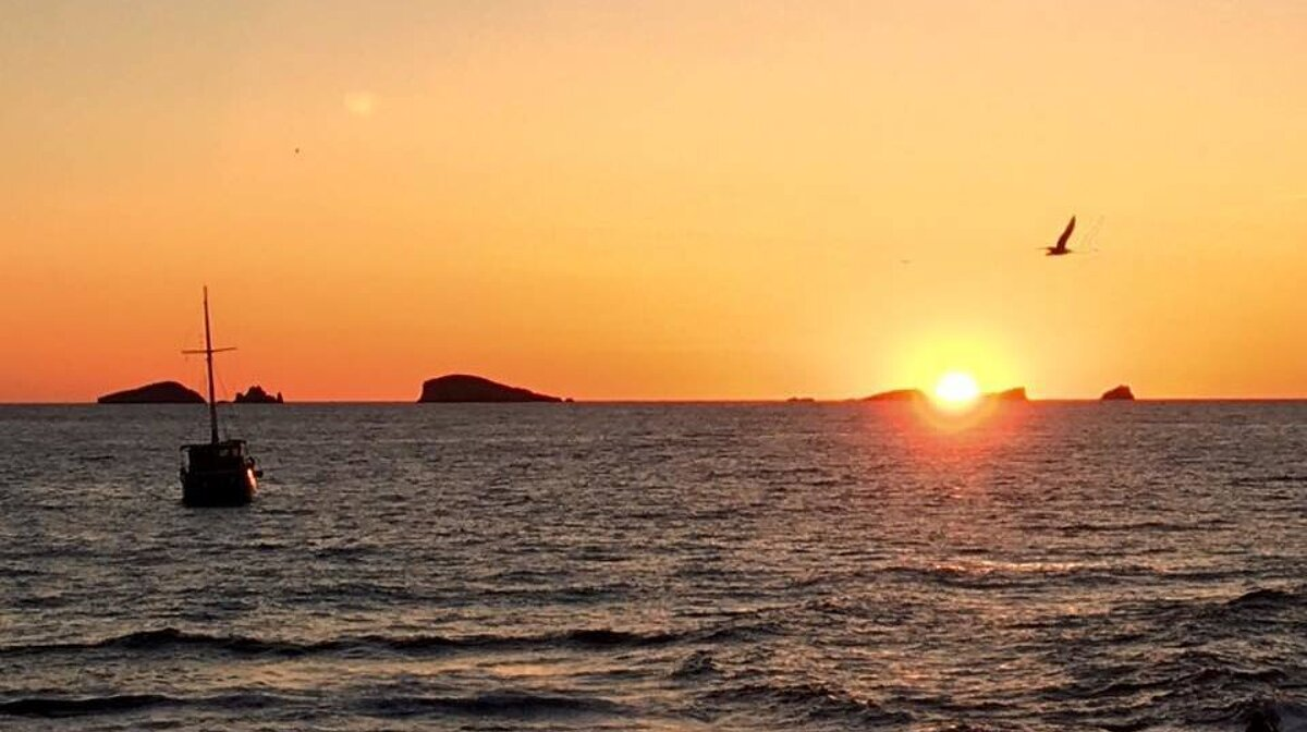 The sunset from a boat in san antonio bay ibiza