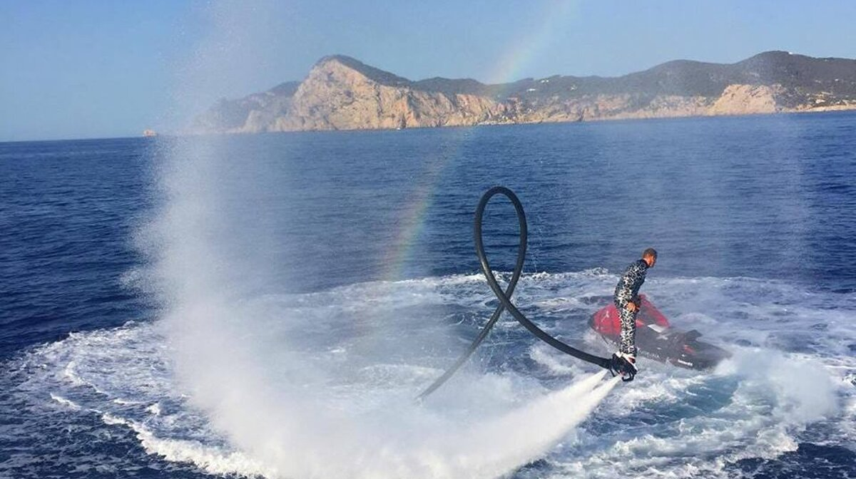 Fly board entertainment in the ater at pukka up boat party in san antonio ibiza