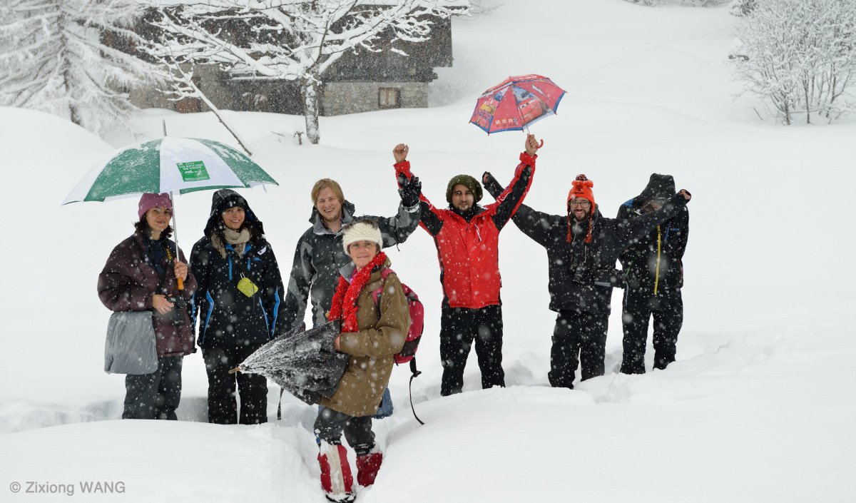 a group of people in the snow on a photography course