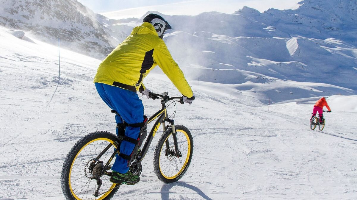 biking on snow in a ski resort