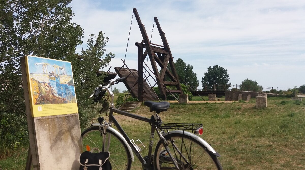 a bike by a bridge in provence