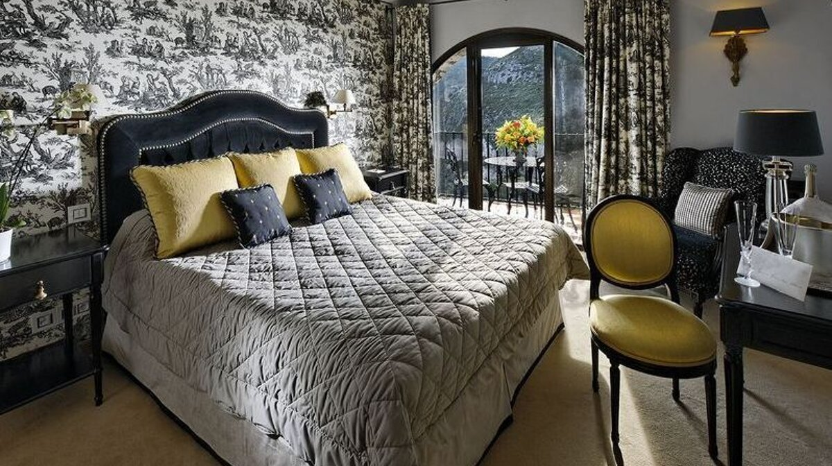 a bedroom in the chateau eza hotel in eze