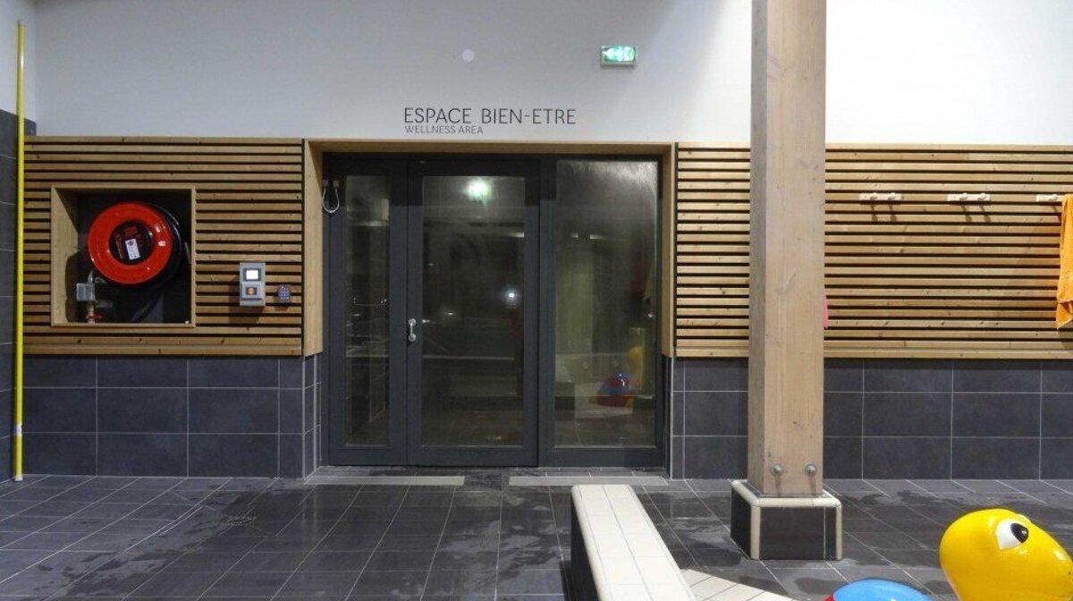 a door to a spa