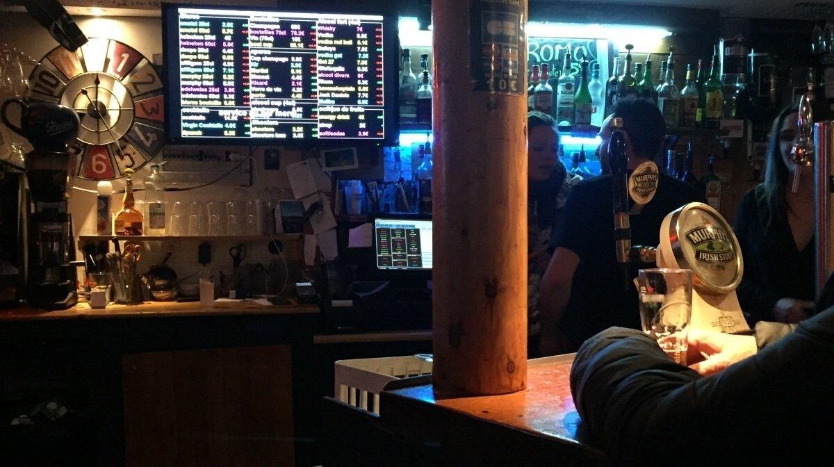 stock trading screen in a bar