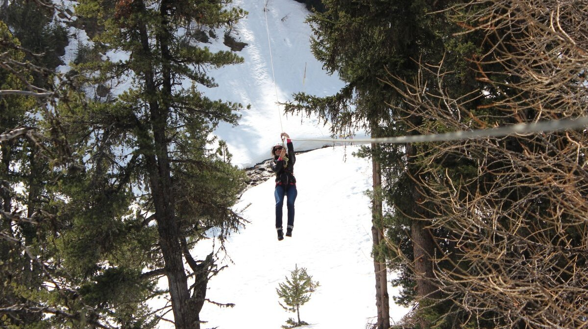 a woman on a zipline in la plagne