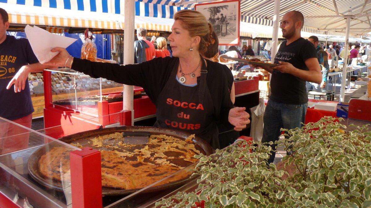 Serving socca in nice market