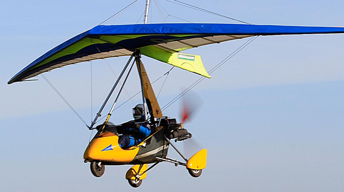 Microlight aircraft in the air above meribel