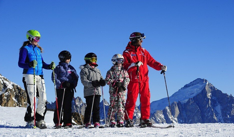a ski instructor giving a group lesson