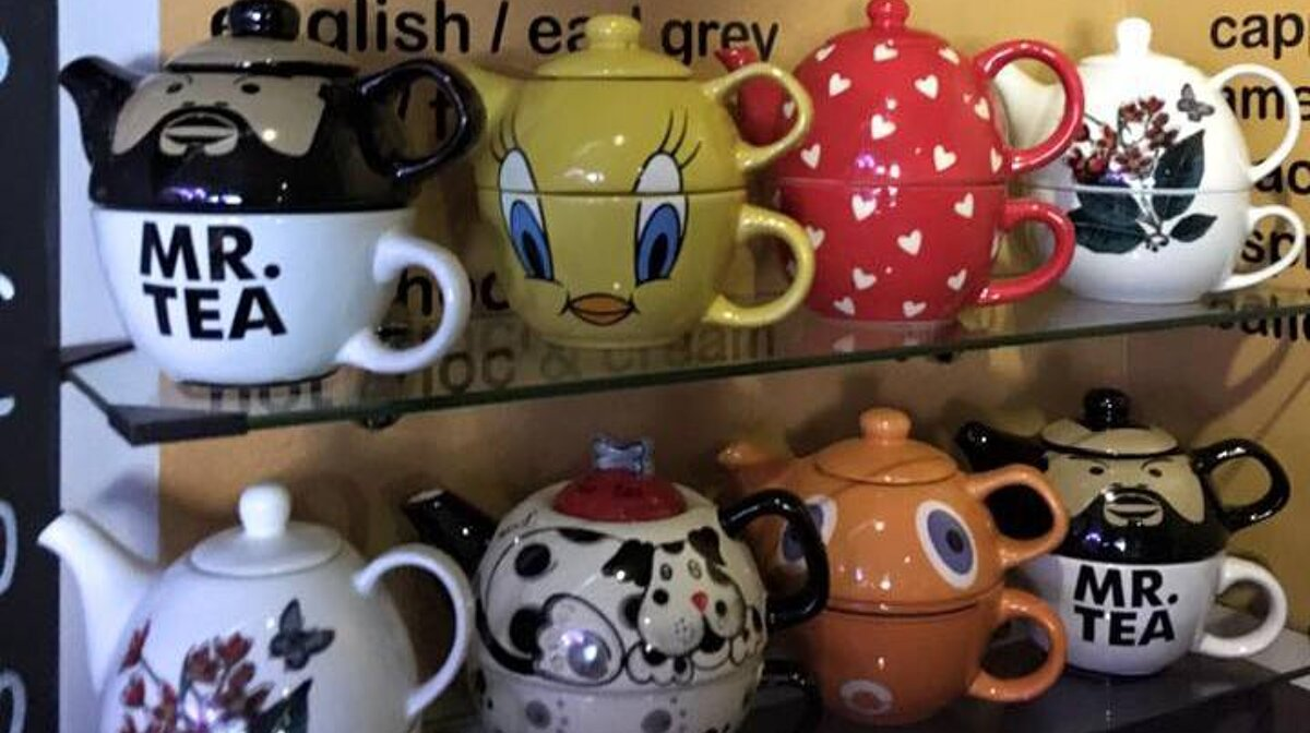 lots of fun teapots on shelves