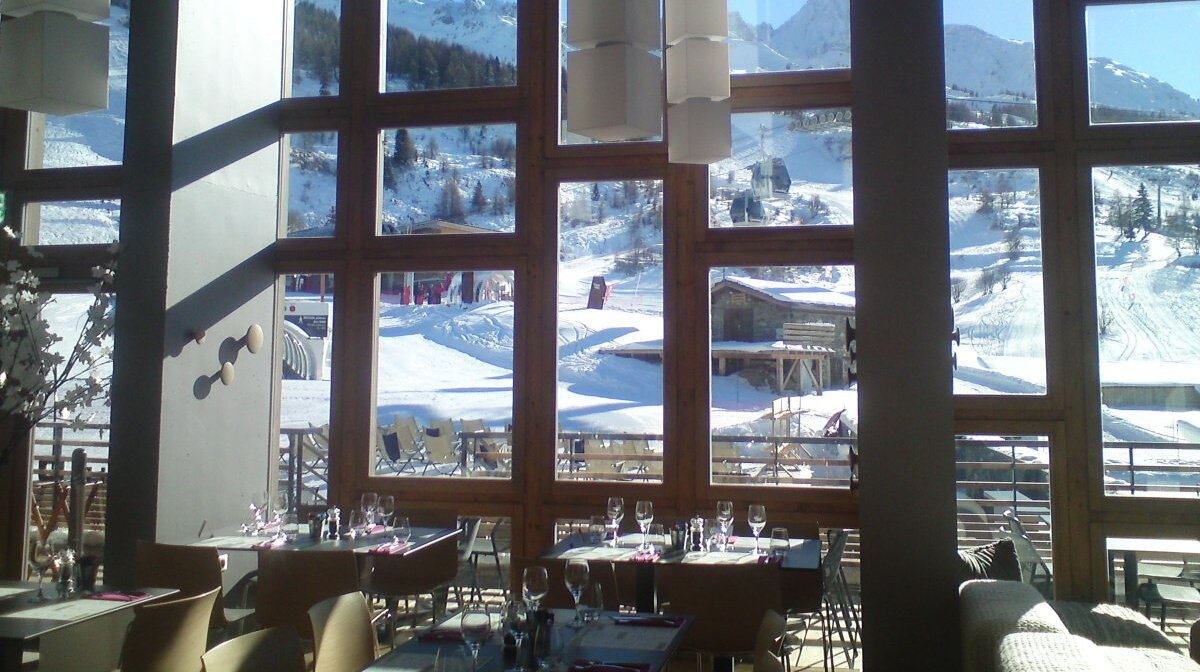 restaurant tables with a mountain view
