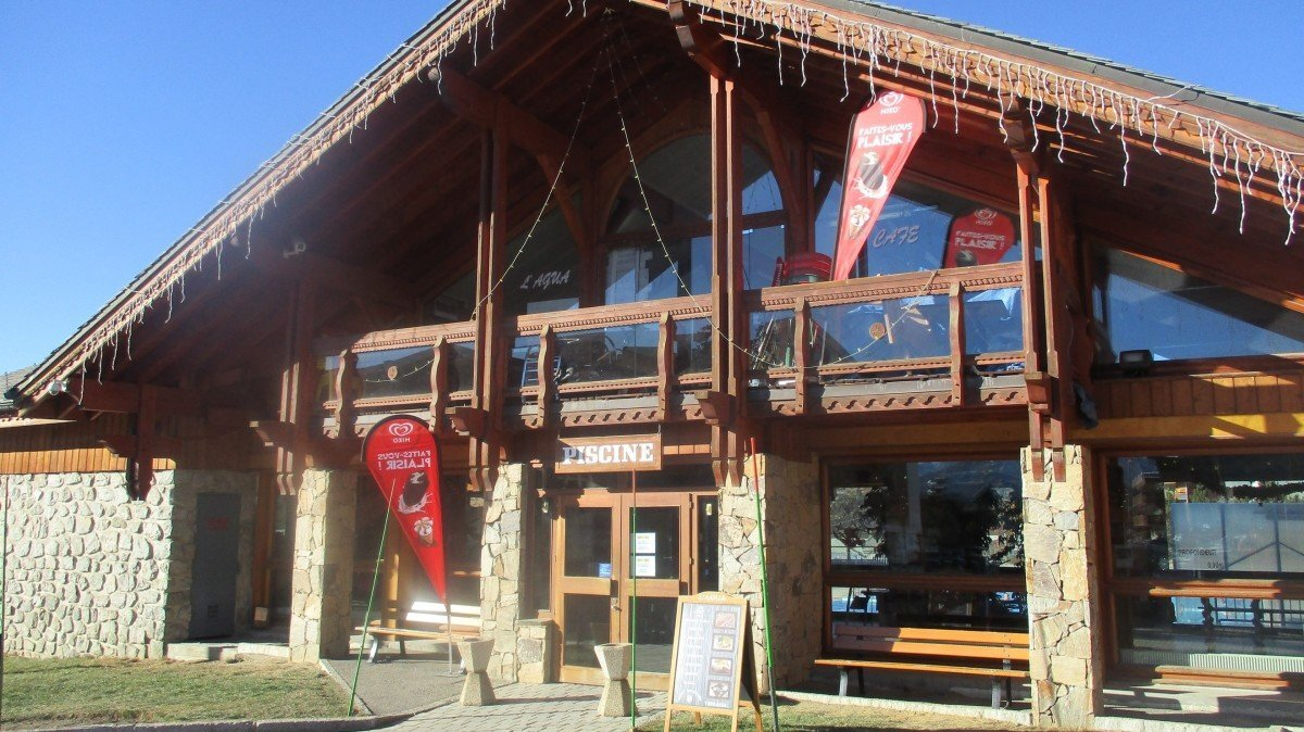 the front of the swimming pool in alpe dhuez