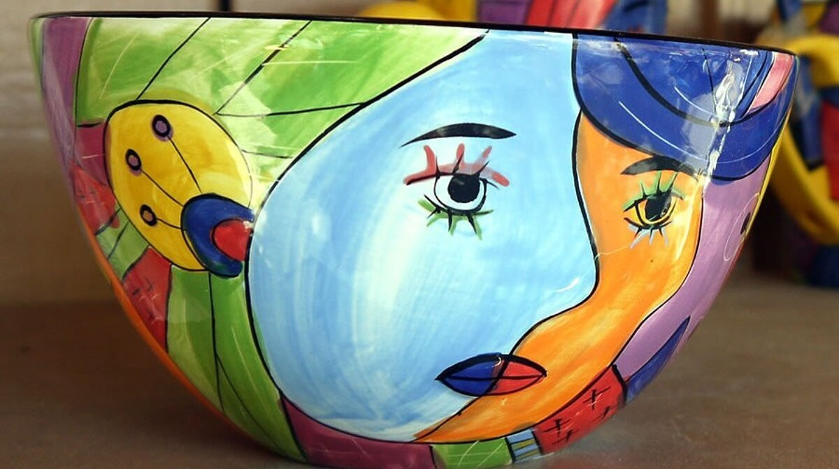 a ceramic bowl with picasso style painting