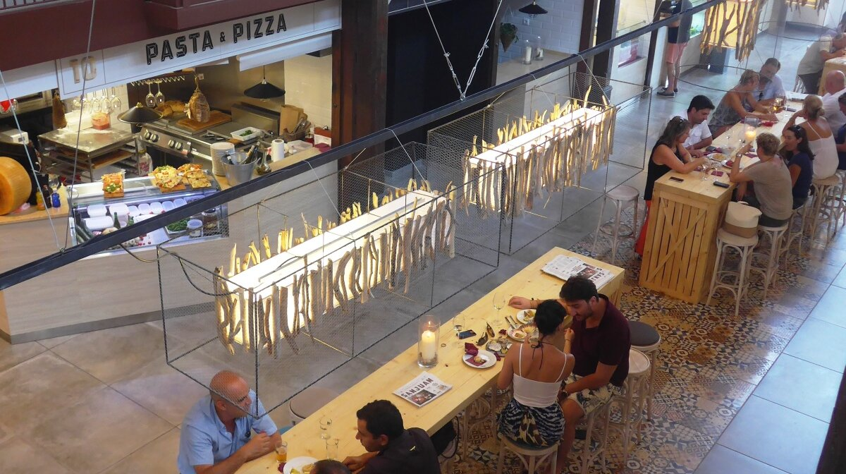 looking down at the tables in san juan gastro food market in palma