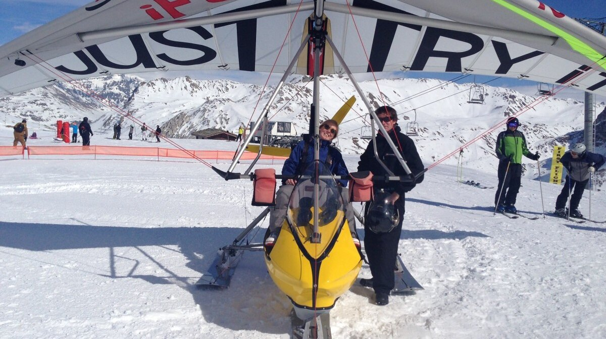 Microlight aircraft in the air above courchevel