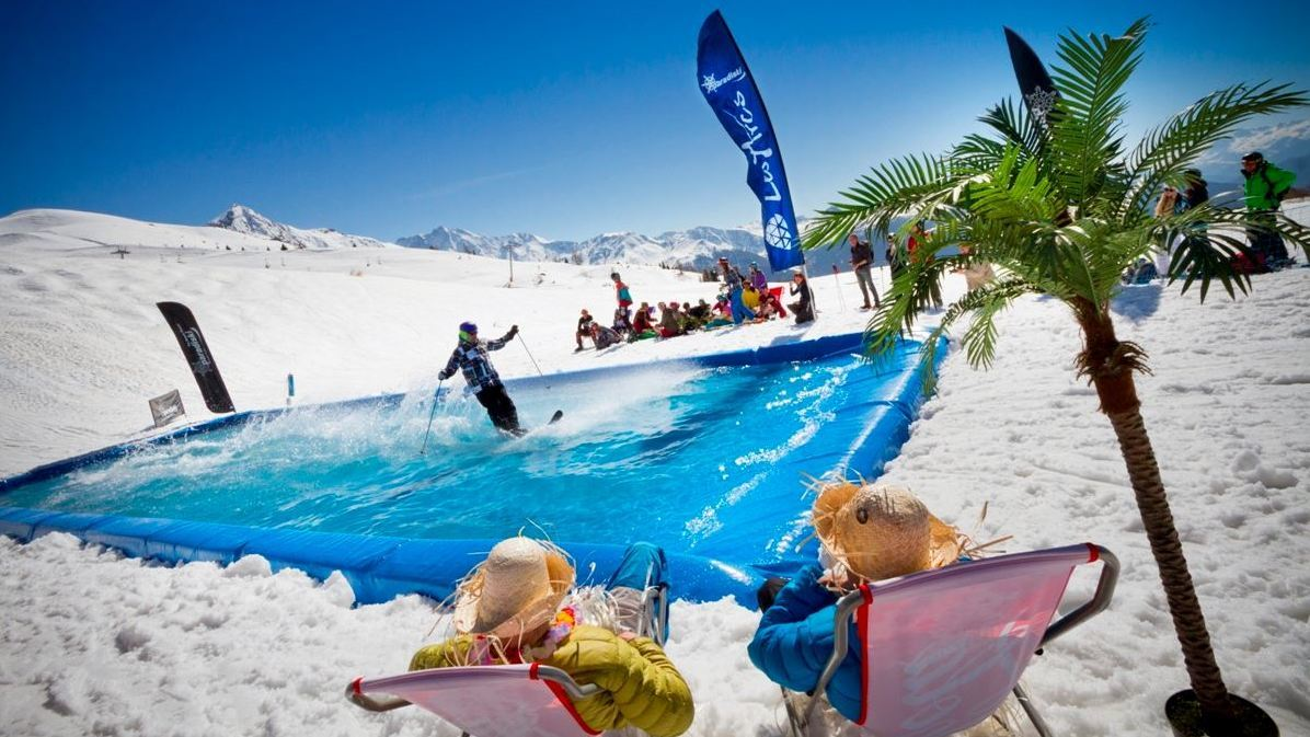 a skier going over a water pool on skis