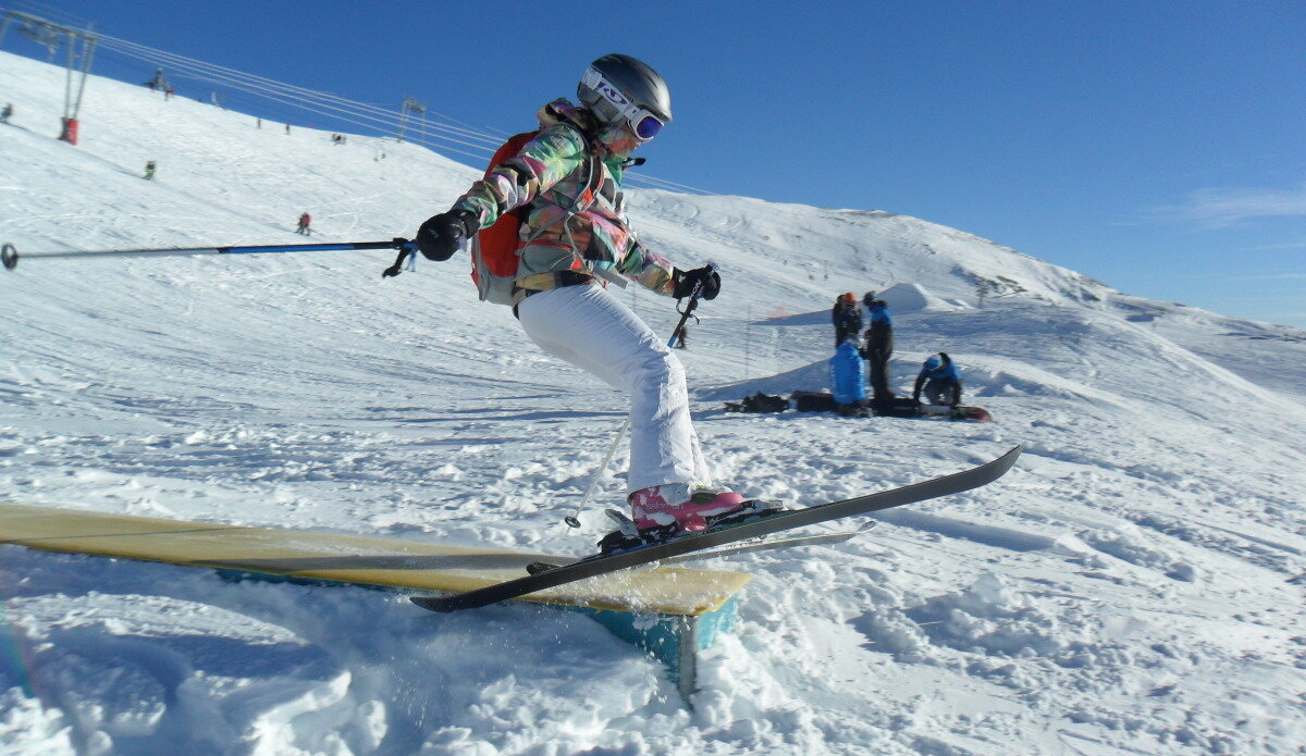a skier going over a box
