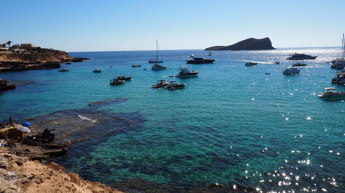 Looking over the bays and water at cala conta in west ibiza