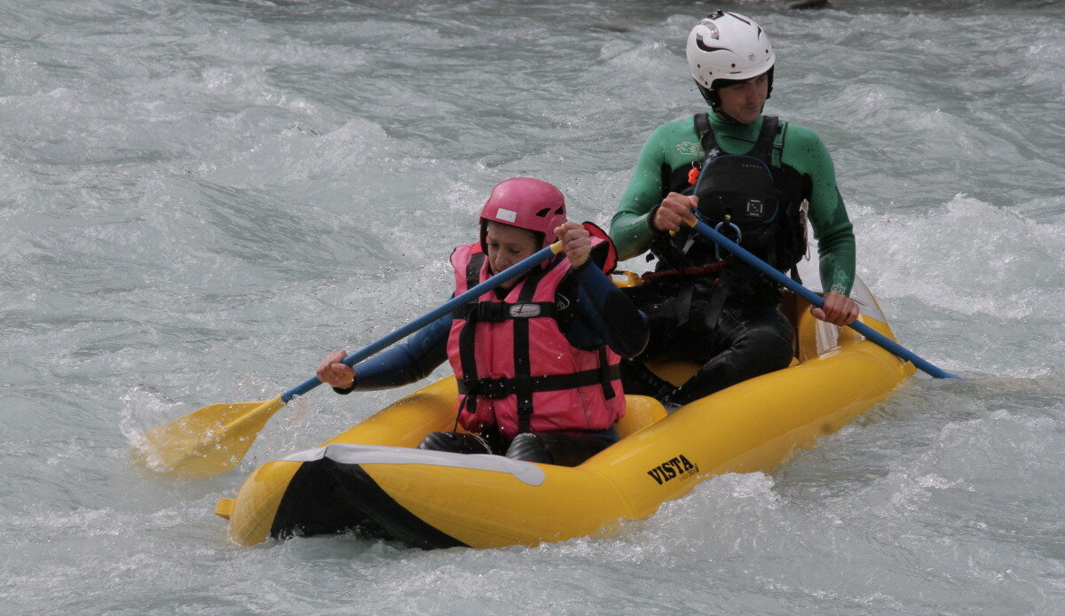 rafting down a white water river