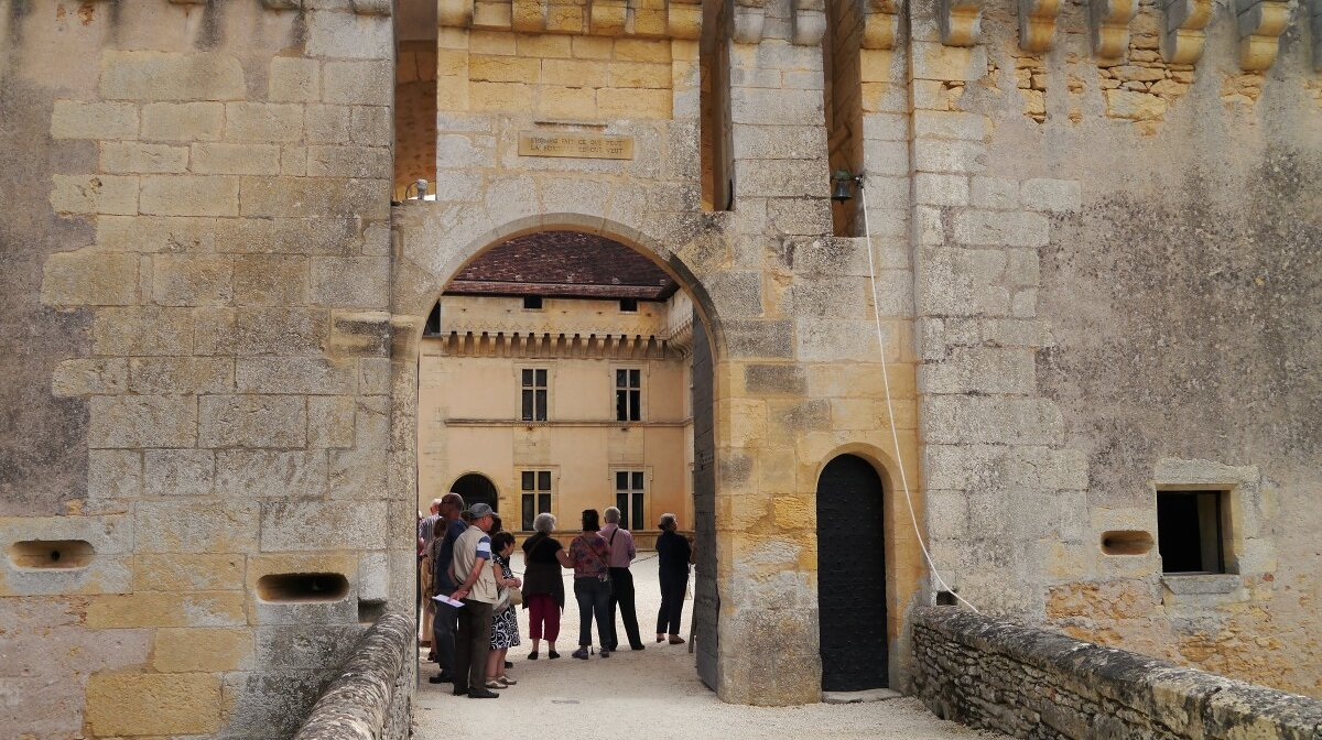 gathering at the gatehouse for the tour of the chateau
