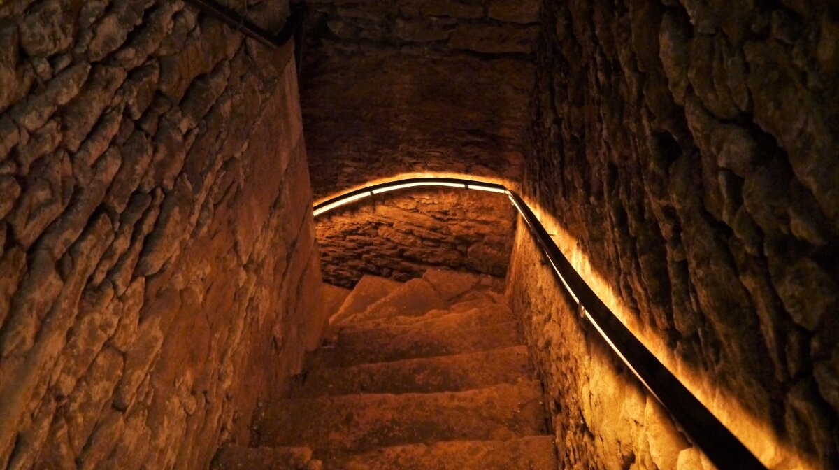 the dark stairwell that leads to the cellars of the turret building