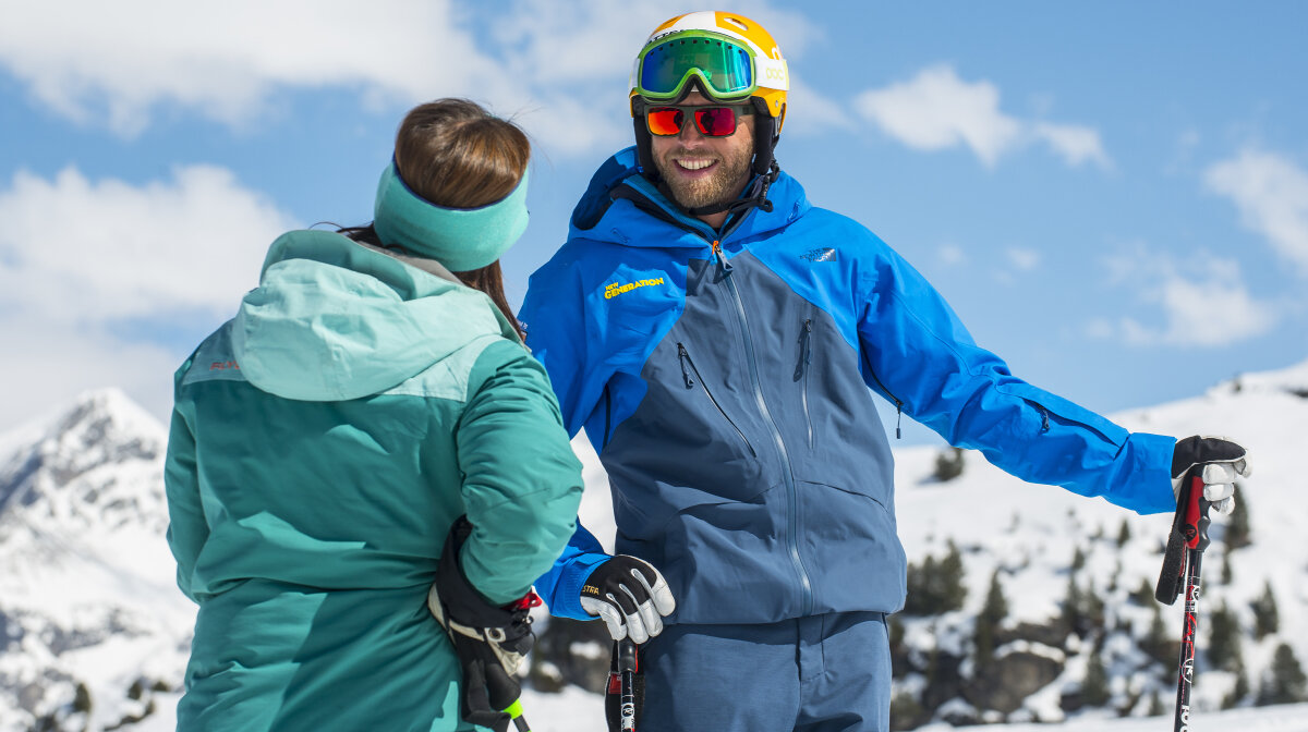 a ski instructor with a client