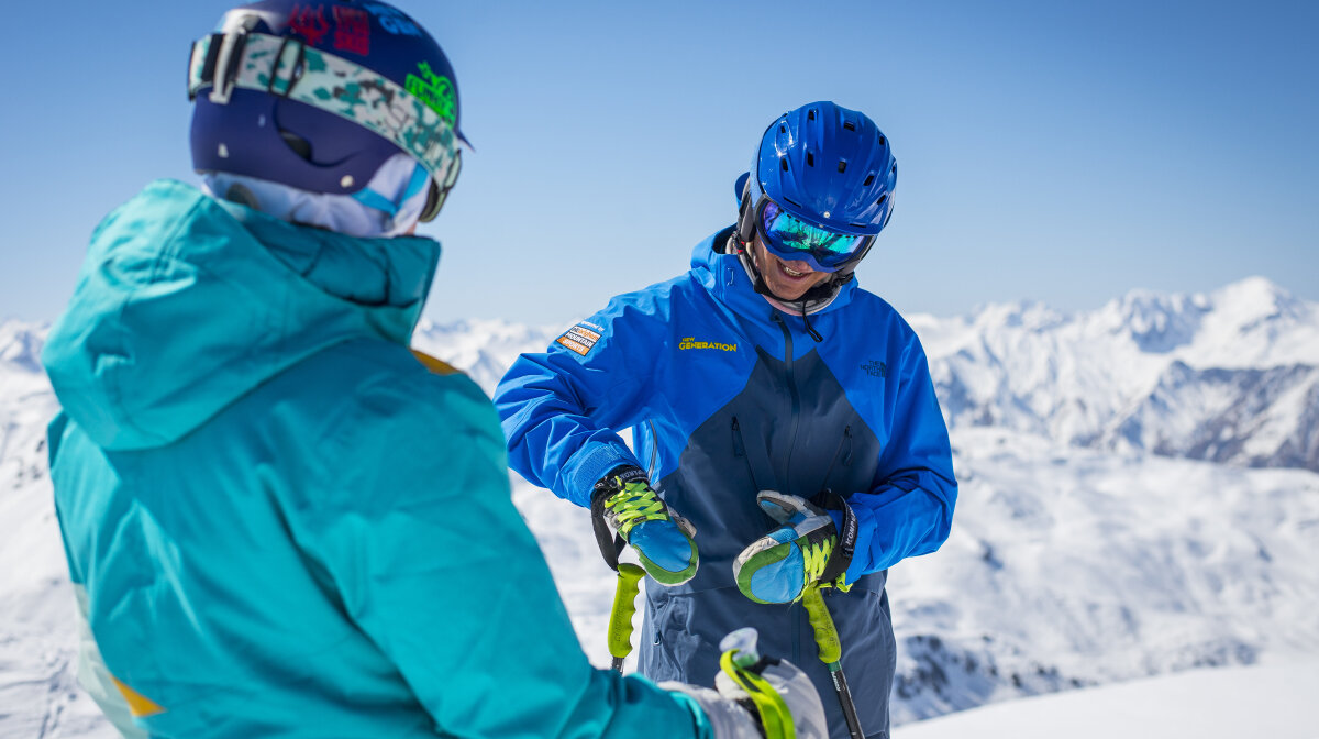 a ski instructor with a pupil