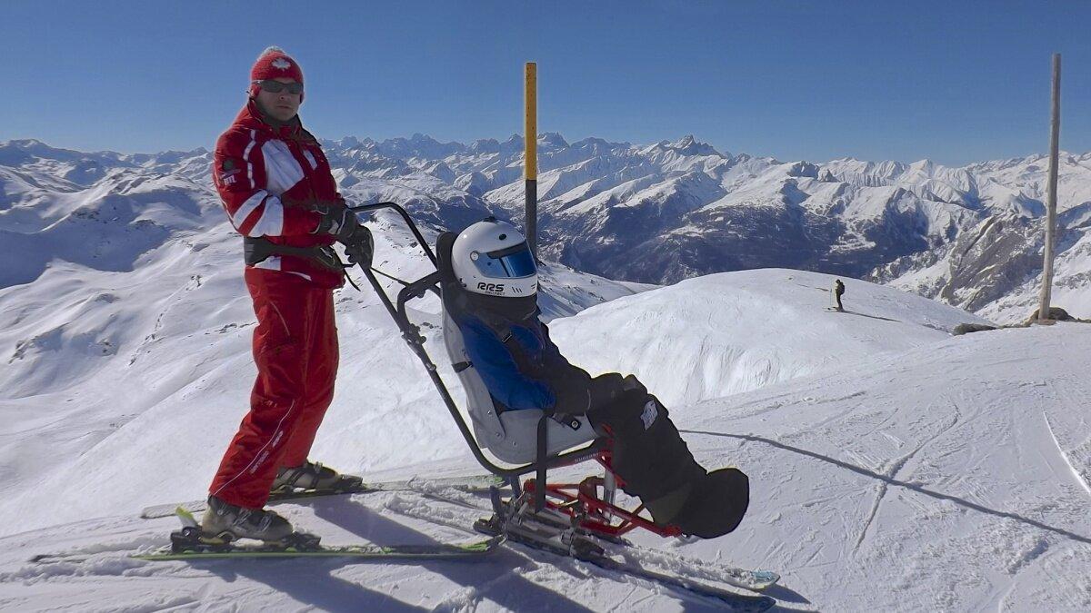 a ski instructor with a man in a sit ski