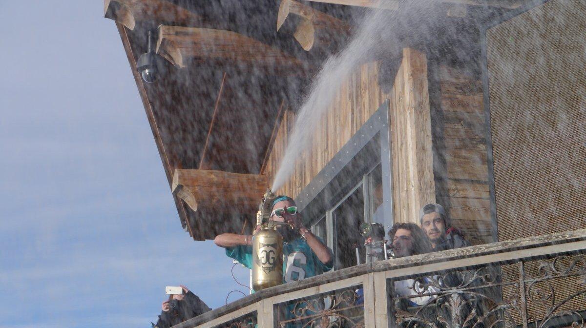 a dj spraying the crowd