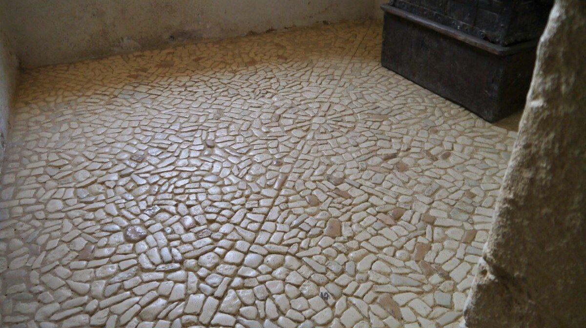typical perigord style flooring made out of small stones in geometric patterns