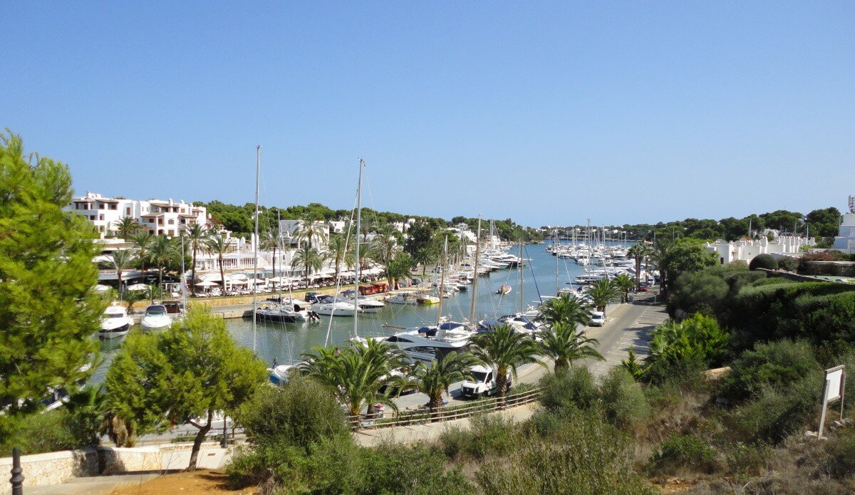photograph or marina with boats and blue sky