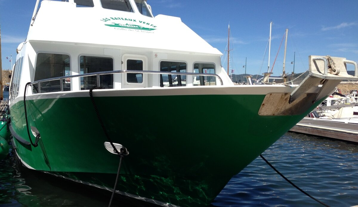 a green & white water taxi in Sainte Maxime