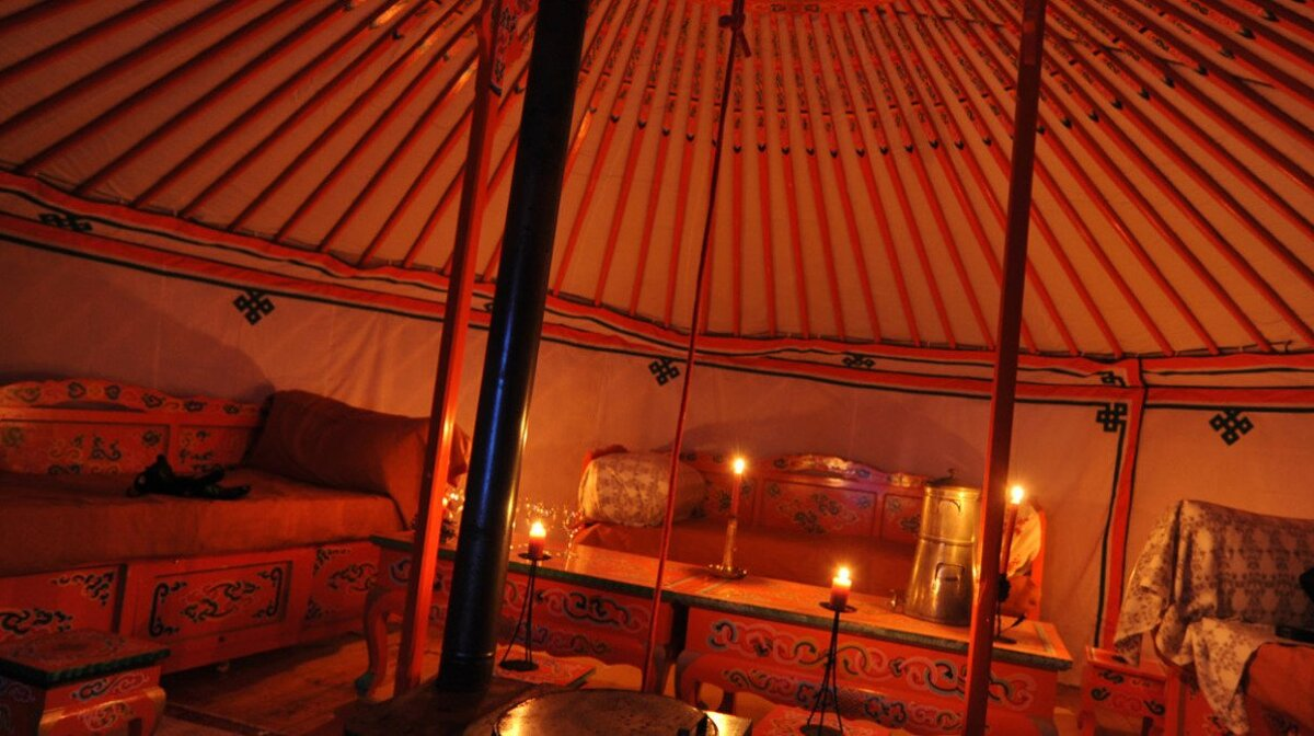 inside of a candlelight yurt in val thorens
