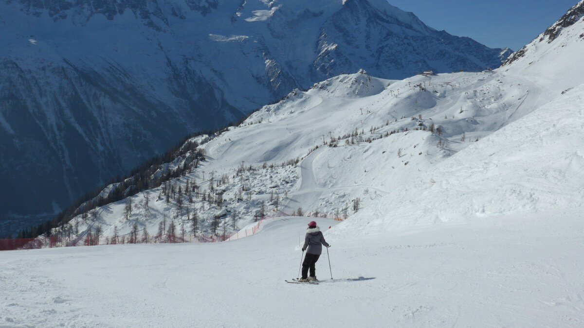 a lone skier in the brevent ski area