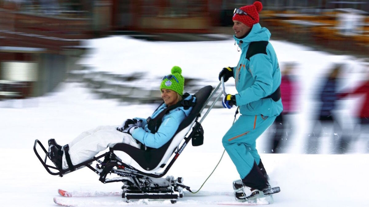 a person using a ski taxi in the ski resort of la plagne