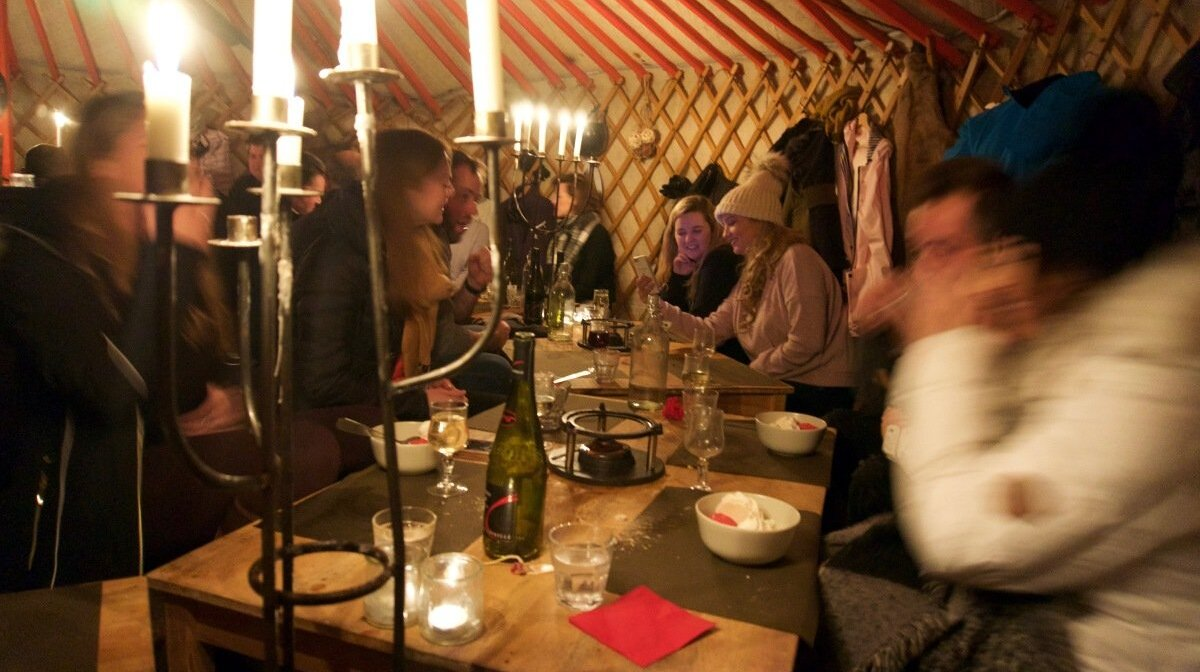 people in a tipi tent in tignes having dinner