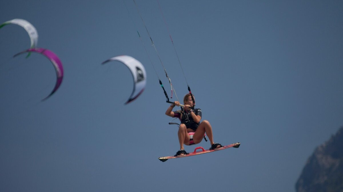 a kitesurfer flying over the water in mallorca