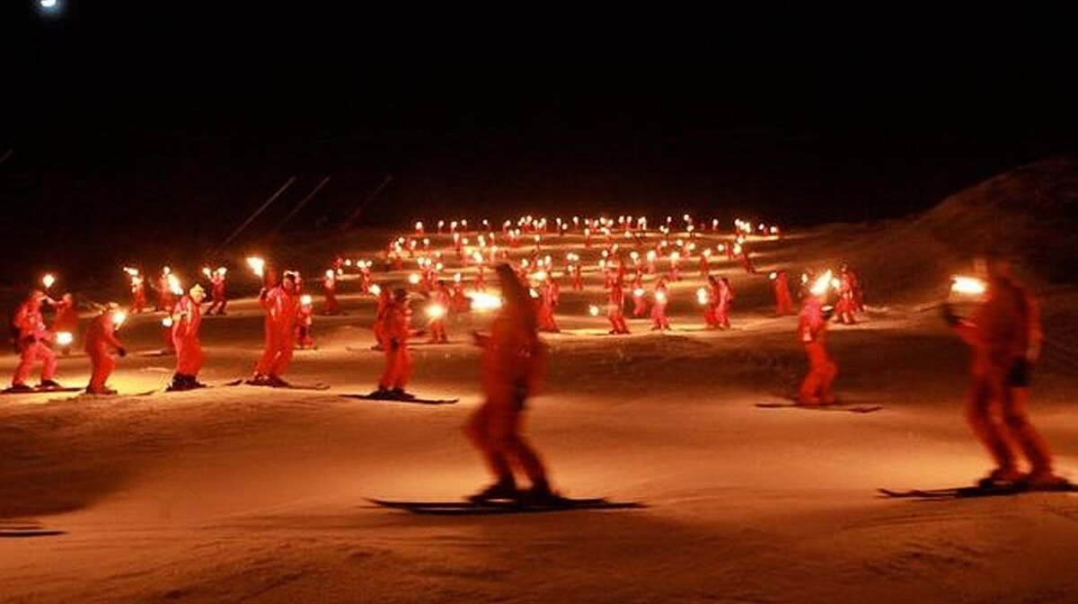 esf instructors doing a torchlit descent in courchevel
