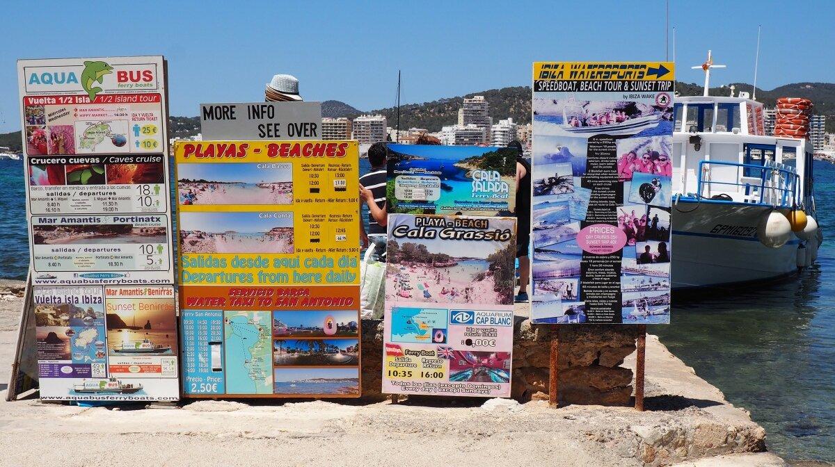 watersports nad boart trips being advertised on s'estanyol beach near san antonio ibiza