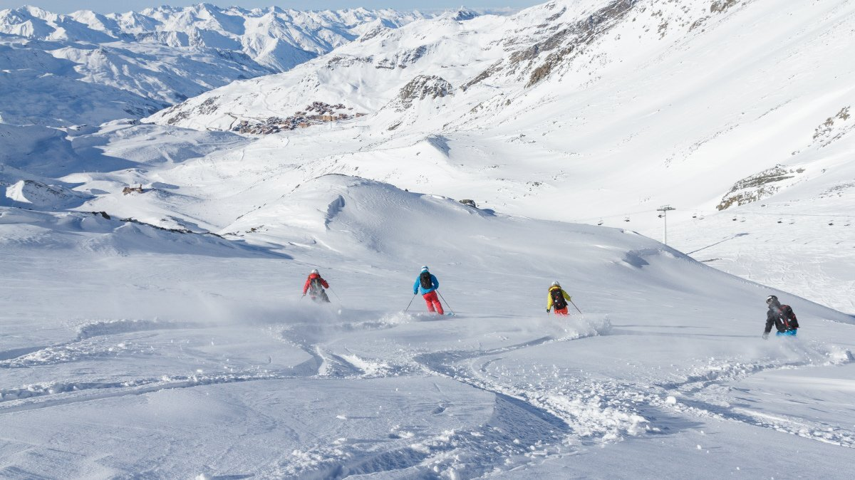 four off piste skiers