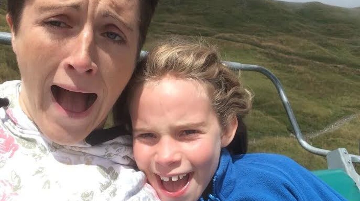 a woman and a child on a chair lift