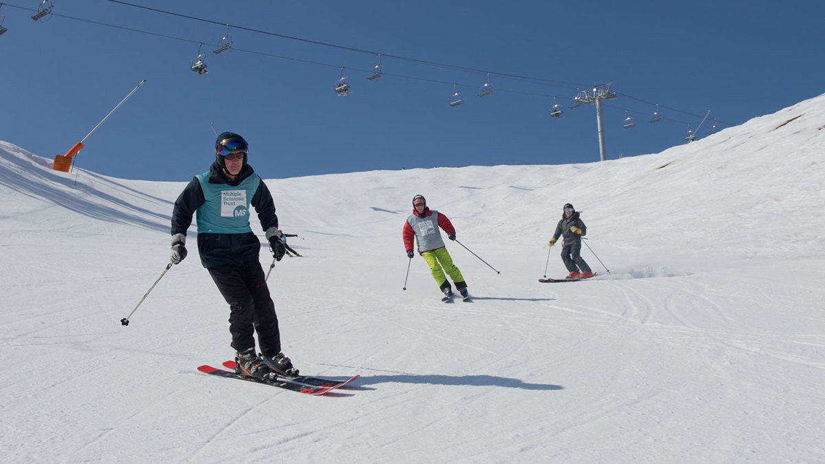 skiers on a piste, chairlift in the sky