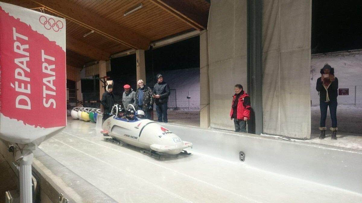 people in a bobsleigh in la plagne