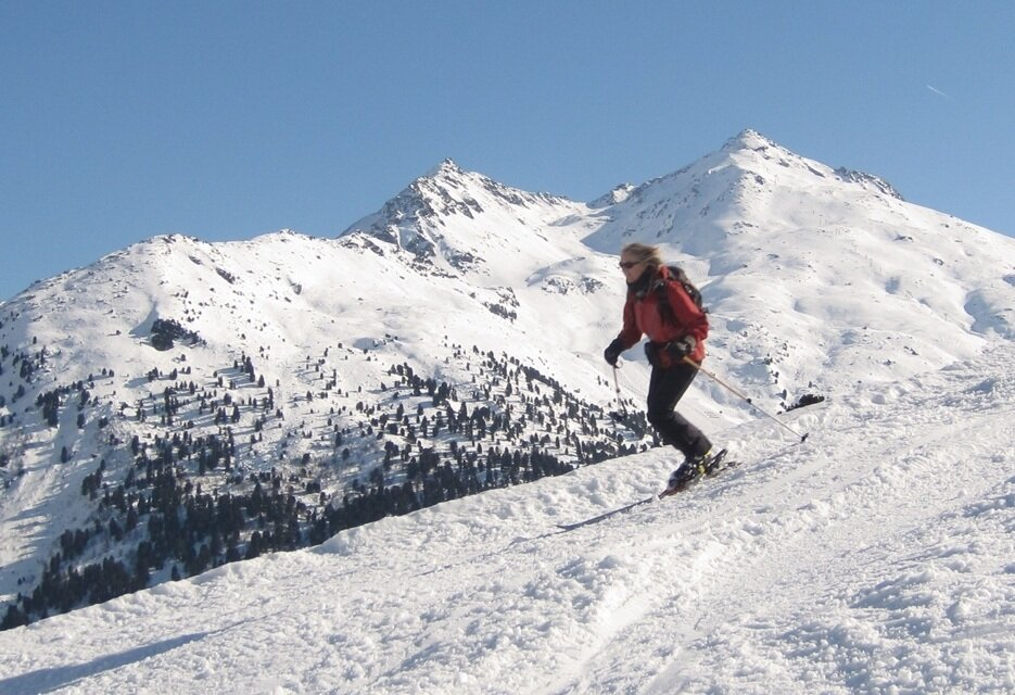 skier with Mont Vallon as background