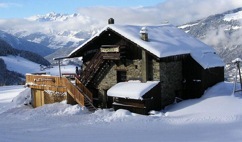 An image of a chalet restaurant in the snow in the ski resort of Montalbert in the French Alps